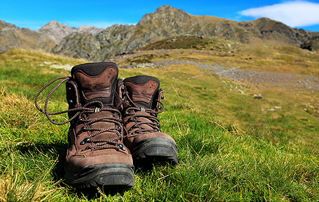 Pair of walking boots in a valley